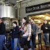 This photo taken on Dec. 7, 2012 shows a tour group walking through the Great Divide Brewery in Denver. A short walk from the 16th Street Mall: a sample of makers of beloved, homegrown Colorado craft beer. Wynkoop Brewing Co., co-founded by Gov. John Hickenlooper, and Great Divide Brewing Co. offer free tours of their downtown operations. (AP Photo/Ed Andrieski)