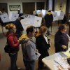 Photo -   Voters pack the polling place at First Christian Church, 1826 16th Street in Moline, Ill. on Tuesday Nov. 6, 2012. The morning rain hasn't deterred voters from heading to the polls today with long lines reported at numerous polling places. (AP Photo/The Dispatch, ) QUAD CITY TIMES OUT