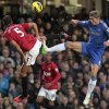 Photo -   Chelsea's Fernando Torres, right, competes with Manchester United's Rio Ferdinand, during their English Premier League soccer match at Stamford Bridge, London, Sunday, Oct. 28, 2012. (AP Photo/Sang Tan)