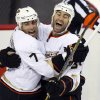 Photo - Anaheim Ducks' Daniel Winnik, right, celebrates his goal against the Calgary Flames with Andrew Cogliano during the third period of their NHL hockey game, Monday, Jan. 21, 2013, in Calgary, Alberta. The Ducks won 5-4. (AP Photo/The Canadian Press, Jeff McIntosh)