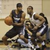 Oklahoma City Thunder\'s Mustafa Shakur (11) looks for an opening around Philadelphia 76ers\' Mike Green (4) during the first half of an NBA summer league basketball game in Orlando, Fla., Wednesday, July 7, 2010. (AP Photo/John Raoux) ORG XMIT: FLJR101