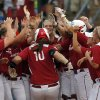Oklahoma celebrates a Oklahoma\'s Keilani Ricketts (10) home run during the third inning of Women\'s College World Series softball game between Oklahoma and Tennessee at ASA Hall of Fame Stadium in Oklahoma City, Tuesday, June, 4, 2013. Photo by Sarah Phipps, The Oklahoman