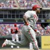 Philadelphia Phillies\' Marlon Byrd rounds the bases after hitting a home run off Texas Rangers relief pitcher Pedro Figueroa during the sixth inning of an opening day baseball game at Globe Life Park, Monday, March 31, 2014, in Arlington, Texas. (AP Photo/Tony Gutierrez)