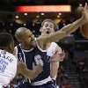 Oklahoma City Thunder\'s Derek Fisher, center, loses the ball as he is trapped by Charlotte Bobcats\' Kemba Walker, front, and Cody Zeller during the second half of an NBA basketball game in Charlotte, N.C., Friday, Dec. 27, 2013. The Thunder won 89-85. (AP Photo/Chuck Burton)