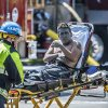 Photo - An injured worker is moved toward a waiting ambulance after an explosion was reported at a business in La Habra, Calif., Tuesday, April 29, 2014. Authorities say eight people have been hurt, three critically, in an explosion and fire at a commercial building in south Los Angeles County. (AP Photo/The Orange County Register, Bruce Chambers)