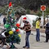 Egyptian protesters decorate a Christmas tree near the presidential palace in Cairo, Egypt, Monday, Dec. 31, 2012. Protesters will celebrate New Year\'s eve in front of the presidential palace. (AP Photo/Amr Nabil)