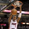 Miami Heat\'s Chris Bosh (1) dunks past Oklahoma City Thunder\'s Kendrick Perkins (5) in the first quarter of Game 3 of the NBA Finals basketball series, Sunday, June 17, 2012, in Miami. (AP Photo/The Miami Herald, Al Diaz) MAGS OUT ORG XMIT: FLMIH202