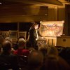"""At the request of Tricia from """"The Oklahoman"""" - Photos from the Edmond Senior Community Foundations\'s Art Auction at Oak Tree 1/26/07. Ella Sprung, from the chamber should be submitting a write-up for the story, but this is Levi Heard, ESCF Board Member, helping to display a painting for auction. Community Photo By: Christian Sangree, Prints Charming Photo Submitted By: Christian, Edmond"""