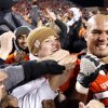 Oklahoma State\'s Jamie Blatnick (50) celebrates with fans during the Bedlam college football game between the Oklahoma State University Cowboys (OSU) and the University of Oklahoma Sooners (OU) at Boone Pickens Stadium in Stillwater, Okla., Saturday, Dec. 3, 2011. Photo by Sarah Phipps, The Oklahoman