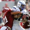 Oklahoma\'s Tom Wort (21) puts a hit on Air Force\'s Chaz Demerath (82) after a reception during the first half of the college football game between the University of Oklahoma Sooners (OU) and the Air Force Falcons at the Gaylord Family - Memorial Stadium on Saturday, Sept. 18, 2010, in Norman, Okla. Photo by Chris Landsberger, The Oklahoman