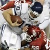 Oklahoma\'s Ronnell Lewis (56) brings down Connecticut\'s Zach Frazer (10)during the Fiesta Bowl college football game between the University of Oklahoma Sooners and the University of Connecticut Huskies in Glendale, Ariz., at the University of Phoenix Stadium on Saturday, Jan. 1, 2011. Photo by Bryan Terry, The Oklahoman