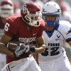 Oklahoma\'s Cameron Kenney (6) makes a reception in front of Air Force\'s Jordan Waiwaiole (32) during the first half of the college football game between the University of Oklahoma Sooners (OU) and the Air Force Falcons at the Gaylord Family - Memorial Stadium on Saturday, Sept. 18, 2010, in Norman, Okla. Photo by Chris Landsberger, The Oklahoman