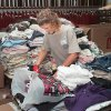 Tornado relief: Moore\'s First Baptist Church. Church member and Moore High School junior Mariah Clark, age 17, working as a volunteer to sort clothes in the church choir room.