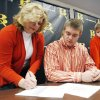 Broken Arrow\'s Zac Veatch and his mother, Kathleen Veatch (left) sign a letter of intent to Oklahoma State University during a ceremony at Broken Arrow High School on Wednesday, February 1, 2012 as Zac Veatch\'s younger brother Will Veatch (right) loks on. MATT BARNARD/Tulsa World