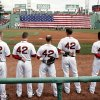 Photo - Boston Red Sox players line up for the National Anthem all wearing number 42 in honor of Jackie Robinson Day before a baseball game between the Red Sox and the Tampa Bay Rays at Fenway Park in Boston Monday, April 15, 2013. (AP Photo/Winslow Townson)
