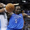 Denver Nuggets center Nene (31) from Brazil and Oklahoma City Thunder center Kendrick Perkins (5) tangle during the second half in game 4 of a first-round NBA basketball playoff series Monday, April 25, 2011, in Denver. Denver beat Oklahoma 104-101. Oklahoma City leads the series 3-1. (AP Photo/Jack Dempsey)