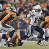 San Diego Chargers running back Ryan Mathews (24) gets past the Denver Broncos defense in the fourth quarter of an NFL football game, Thursday, Dec. 12, 2013, in Denver. (AP Photo/Joe Mahoney)