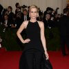 """Kristen Wiig attends The Metropolitan Museum of Art\'s Costume Institute benefit gala celebrating """"Charles James: Beyond Fashion"""" on Monday, May 5, 2014, in New York. (Photo by Evan Agostini/Invision/AP)"""