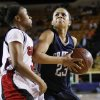 Shawnee\'s Kelsee Grovey (23) moves to the basket against East Central\'s Janee Arnold (3) during the Class 5A girls high school basketball state tournament championship game between Shawnee and East Central at the Mabee Center in Tulsa, Okla., Saturday, March 10, 2012. Shawnee won, 45-41. Photo by Nate Billings, The Oklahoman