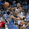 Oklahoma City\'s Kyle Weaver goes by Washington\'s Javaris Crittenton during the NBA basketball game between the Oklahoma City Thunder and the Washington Wizards at the Ford Center in Oklahoma City, Wed., March 4, 2009. PHOTO BY BRYAN TERRY, THE OKLAHOMAN