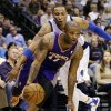 Phoenix Suns\' P.J. Tucker (17) drives past Dallas Mavericks\' Shawn Marion, rear, in the first half of an NBA basketball game, Sunday, Jan. 27, 2013, in Dallas. (AP Photo/Tony Gutierrez)