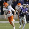 Photo - Kansas State's Tyler Lockett (16) runs past Oklahoma State's Quinn Sharp (13) on a kick return for a touchdown during the college football game between the Oklahoma State University Cowboys (OSU) and the Kansas State University Wildcats (KSU) at Bill Snyder Family Football Stadium on Saturday, Nov. 1, 2012, in Manhattan, Kan. Photo by Chris Landsberger, The Oklahoman
