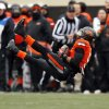 Oklahoma State\'s Josh Stewart (5) lands after making a catch in the third quarter during the Bedlam college football game between the Oklahoma State University Cowboys (OSU) and the University of Oklahoma Sooners (OU) at Boone Pickens Stadium in Stillwater, Okla., Saturday, Dec. 7, 2013. OU won, 33-24. Photo by Nate Billings, The Oklahoman