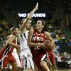 Photo - Western Kentucky's Kendall Noble (12) drives to the basket against Baylor's Makenzie Robertson, left, in the first half of a first-round game in the NCAA women's college basketball tournament, Saturday, March 22, 2014, in Waco, Texas. (AP Photo/Tony Gutierrez)