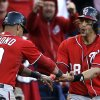 Washington Nationals\' Ian Desmond, left, and Michael Morse celebrate after scoring on a two-RBI single by Tyler Moore during the eighth inning in Game 1 of baseball\'s National League division series against the St. Louis Cardinals, Sunday, Oct. 7, 2012, in St. Louis. (AP Photo/Jeff Roberson)