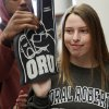 Amanda Dial has her ORU foam finger taken away by Caleb McCain, an Edmond Memorial basketball player, during signing day for student athletes at Edmond Memorial High School in Edmond, Okla., Wednesday, Feb. 5, 2014. Dial signed to play soccer at Oral Roberts University. Photo by Nate Billings, The Oklahoman