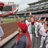 Photo - Washington Nationals' Denard Span, left, celebrates his solo home run with his teammates during the first inning of a baseball game against the Cincinnati Reds at Nationals Park Wednesday, May 21, 2014, in Washington. (AP Photo/Alex Brandon)