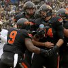 Oklahoma State\'s Jeremy Seaton (44) celebrates with teammates after a touchdown during the Heart of Dallas Bowl football game between Oklahoma State University and Purdue University at the Cotton Bowl in Dallas, Tuesday, Jan. 1, 2013. Oklahoma State won 58-14. Photo by Bryan Terry, The Oklahoman