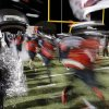 Westmoore Jaguars run onto the field during the high school football game between Broken Arrow and Westmoore at Moore stadium Friday , November 8, 2013. Photo by Doug Hoke, The Oklahoman