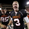 OSU\'s Brandon Weeden (3) celebrates with kicker Dan Bailey (95) following the college football game between Texas A&M University (TAMU) and Oklahoma State University (OSU) at Boone Pickens Stadium in Stillwater, Okla., Thursday, Sept. 30, 2010. Photo by Sarah Phipps, The Oklahoman