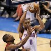 Oklahoma City\'s Russell Westbrook (0) goes to the basket beside Miami\'s Dwyane Wade (3) during Game 1 of the NBA Finals between the Oklahoma City Thunder and the Miami Heat at Chesapeake Energy Arena in Oklahoma City, Tuesday, June 12, 2012. Photo by Nate Billings, The Oklahoman