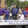 Members of the Military Order of the Purple Heart salute as they pass the viewing stand during the LibertyFest Parade in downtown Edmond, OK, Saturday, July 4, 2009. By Paul Hellstern, The Oklahoman