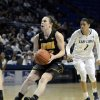 Photo - Iowa's Samantha Logic (22) moves into the paint during the second half of an NCAA college basketball game on Thursday, Feb. 6, 2014 in State College, Pa. (AP Photo/Ralph Wilson)