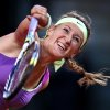 Belarus\' Victoria Azarenka serves against German Mona Barthel during their quarterfinal match at the Porsche tennis Grand Prix in Stuttgart, Germany, Friday, April 27, 2012. (AP Photo/Michael Probst) ORG XMIT: PSTU107
