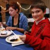 Ashley Skinnell and Aiden Walton, 8, eat latkas made by University of Oklahoma students at the Hillel foundation\'s Latkas for Love annual fundraiser on Thursday, Nov. 29, 2012, in Norman, Okla. Photo by Steve Sisney, The Oklahoman