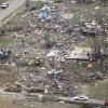 Emergency workers go through the rubble of heavily damaged homes in Granbury, Texas on Thursday May 16, 2013. Ten tornadoes touched down in several small communities in North Texas overnight, leaving at least six people dead, dozens injured and hundreds homeless. (AP Photo/Star-Telegram,Ron T. Ennis) MAGS OUT; (FORT WORTH WEEKLY, 360 WEST)
