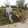 Mark Sarlo drags a branch to the street in the Dripping Springs Estates Saturday, May 15, 2010. Saturday hundreds of volunteers went into areas that had been affected by last week\'s tornadoes to help clear debris. Photo by Doug Hoke, The Oklahoman.