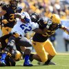 Photo - Georgia State's Jonathan Jean-Bart (22) is tackled by West Virginia's Dontrill Hyman (99) and Tyler Anderson (53) during the second quarter of an NCAA college football game in Morgantown, W.Va., on Saturday, Sept. 14, 2013. (AP Photo/Christopher Jackson)