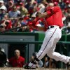 Photo - Washington Nationals catcher Wilson Ramos hits a two-RBI single during the fifth inning of a baseball game against the New York Mets at Nationals Park Sunday, May 18, 2014, in Washington. (AP Photo/Alex Brandon)