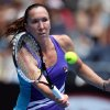 Photo - Jelena Jankovic of Serbia makes a forehand return to Kurumi Nara of Japan during their third round match at the Australian Open tennis championship in Melbourne, Australia, Saturday, Jan. 18, 2014.(AP Photo/Rick Rycroft)