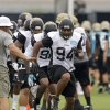 Jacksonville Jaguars defensive end Jeremy Mincey (94) runs through a drill with teammates during NFL football training camp on Sunday, July 28, 2013, in Jacksonville, Fla. (AP Photo/John Raoux)