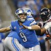 Photo - Detroit Lions quarterback Matthew Stafford (9) throws during the first quarter of an NFL football game against the Chicago Bears at Ford Field in Detroit, Sunday, Sept. 29, 2013. (AP Photo/Paul Sancya)