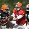 Brandon Weeden has a new coaching staff and a new GM in Cleveland, but he doesn\'t have much in the way of more help on the field. The former Oklahoma State standout will get his turn running Norv Turner\'s offense, though. Might that be enough to turn the Browns around? (AP Photo/Mark Duncan)