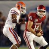 Florida\'s Brandon Hicks (40) wraps up Oklahoma\'s Sam Bradford (14) for a sack in the first half of the BCS National Championship college football game between the University of Oklahoma Sooners (OU) and the University of Florida Gators (UF) on Thursday, Jan. 8, 2009, at Dolphin Stadium in Miami Gardens, Fla. PHOTO BY NATE BILLINGS, THE OKLAHOMAN