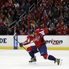 Photo - Washington Capitals right wing Alex Ovechkin (8), from Russia, celebrates his goal in the first period of an NHL hockey game against the Nashville Predators, Saturday, Dec. 7, 2013, in Washington. (AP Photo/Alex Brandon)