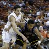 Coppin State\'s Patrick Cole (1) is pressured by Texas\' Ioannis Papapetrou, left, during the first half of an NCAA college basketball game, Monday, Nov. 12, 2012, in Austin, Texas. (AP Photo/Eric Gay)